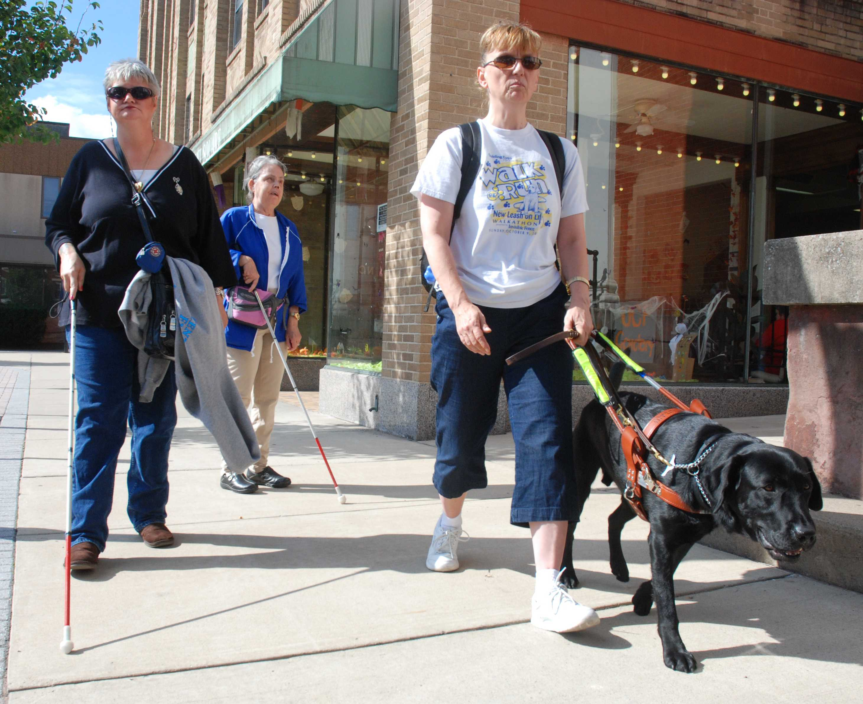 Three of our clients walking down the sidewalk in Lewistown, PA